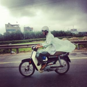 Man on a motorbike on his way into the future